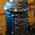Very rare hard to find Round Oak E-12'' Stove. Restored with a small three feathered Indian finial $4250